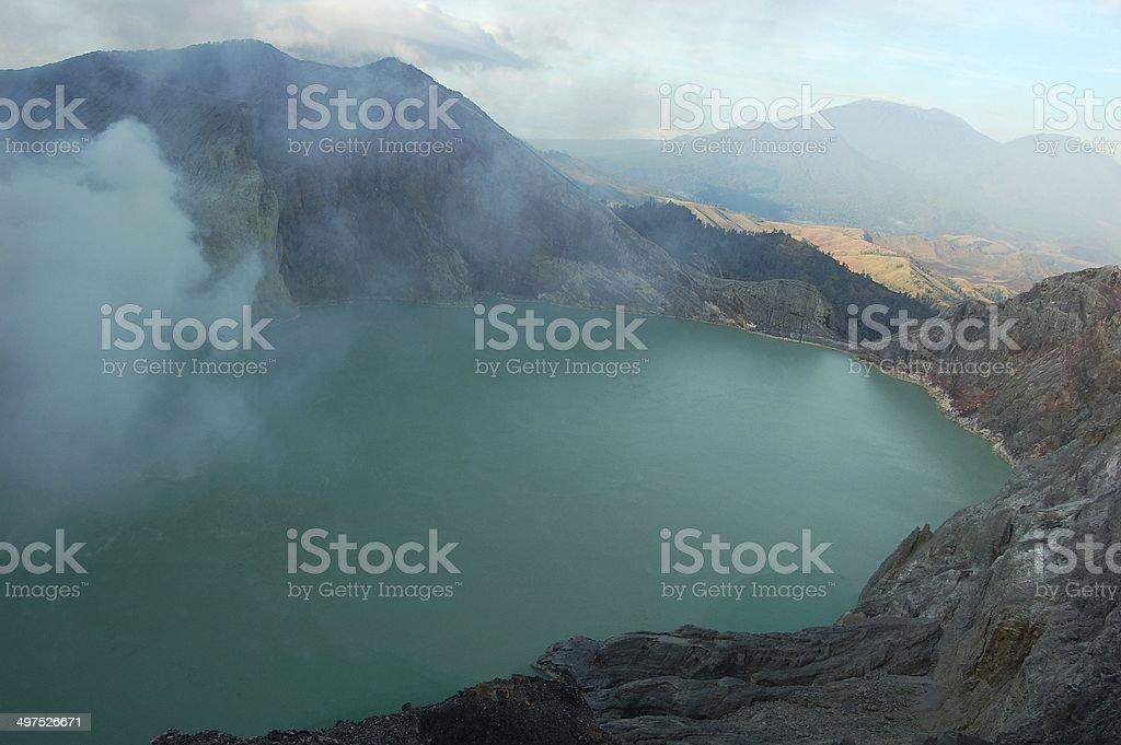 Acid Lake, Kawah Ijen Volcano gets covered in dog stock photo