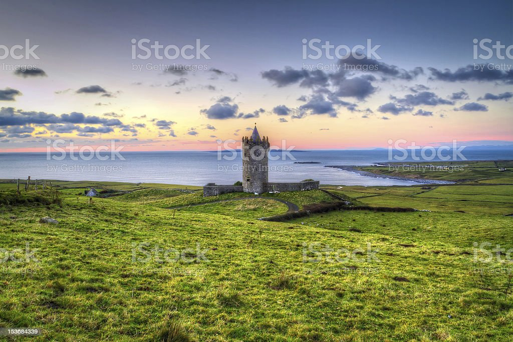 Acient tower on the coast of Co. Clare at sunset stock photo