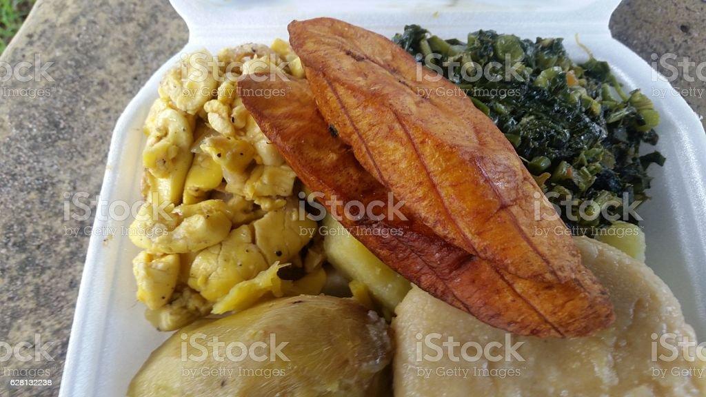 Ackee plantain and callaloo breakfast stock photo