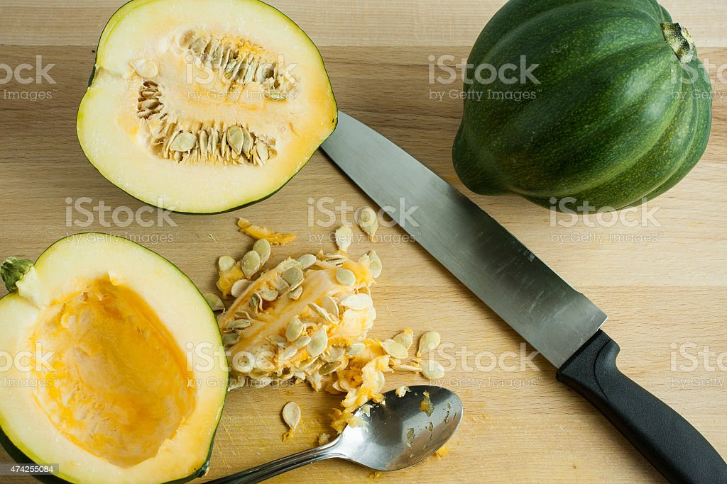 Acorn Squash on a Cutting Board stock photo