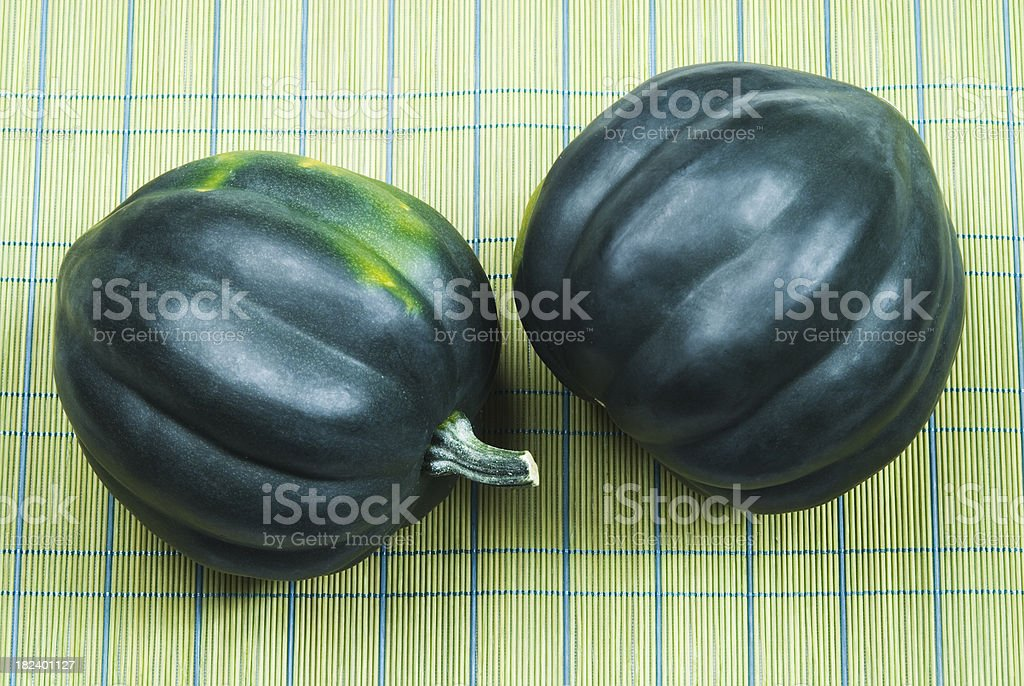 Acorn (Winter) squash on bamboo mat stock photo