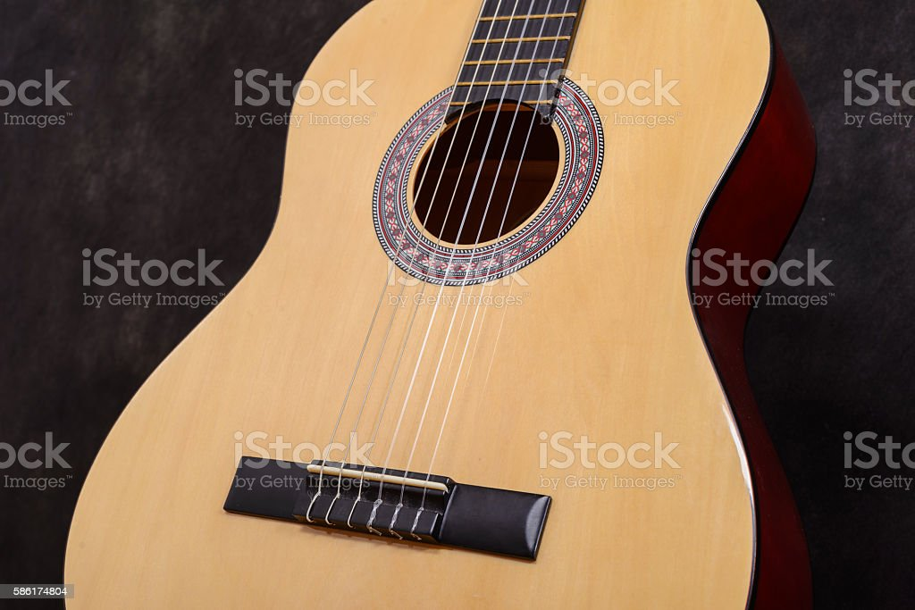 Acoustic classical guitar. Close-up deck and strings stock photo