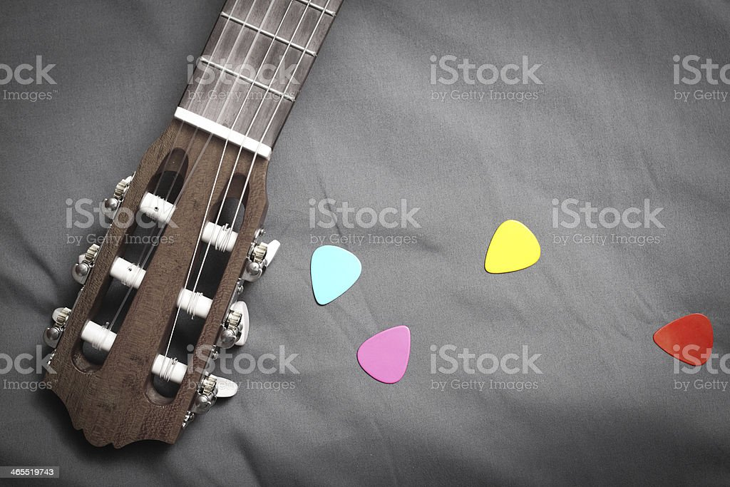 acoustic guitar and colorful picks royalty-free stock photo