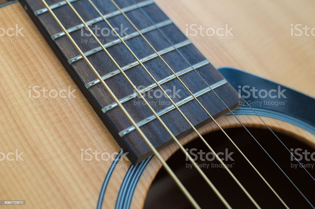 Acoustic Guitar closeup of hole and neck stock photo