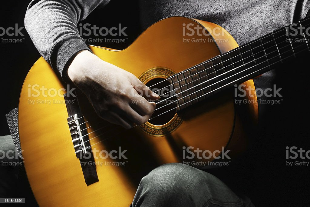 Acoustic guitar guitarist playing. stock photo
