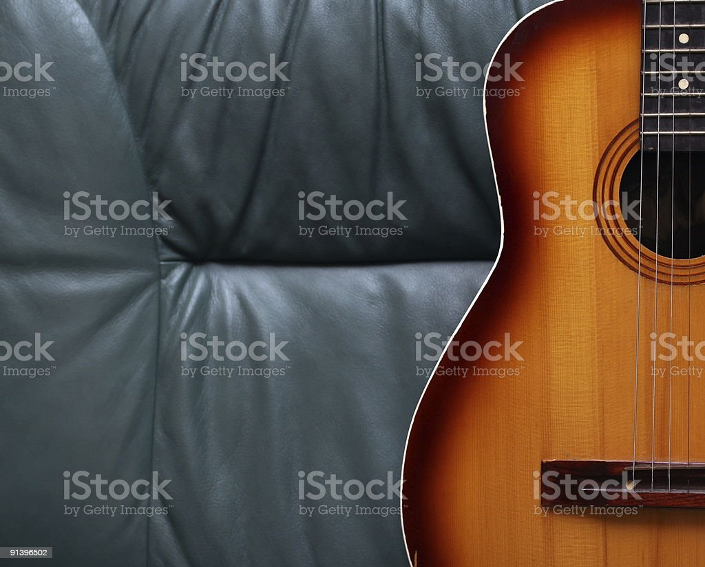 Acoustic Guitar Isolated On Leather royalty-free stock photo