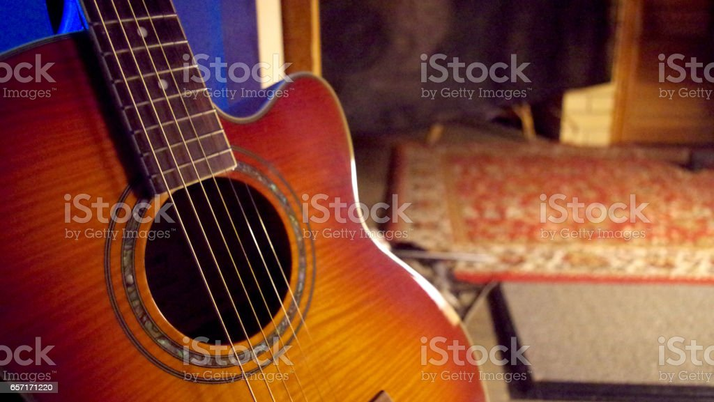 Acoustic Guitar on a Dark Background stock photo