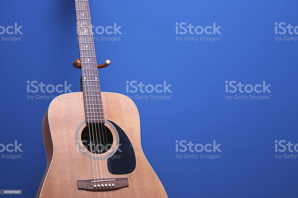 Acoustic Guitar on Blue royalty-free stock photo