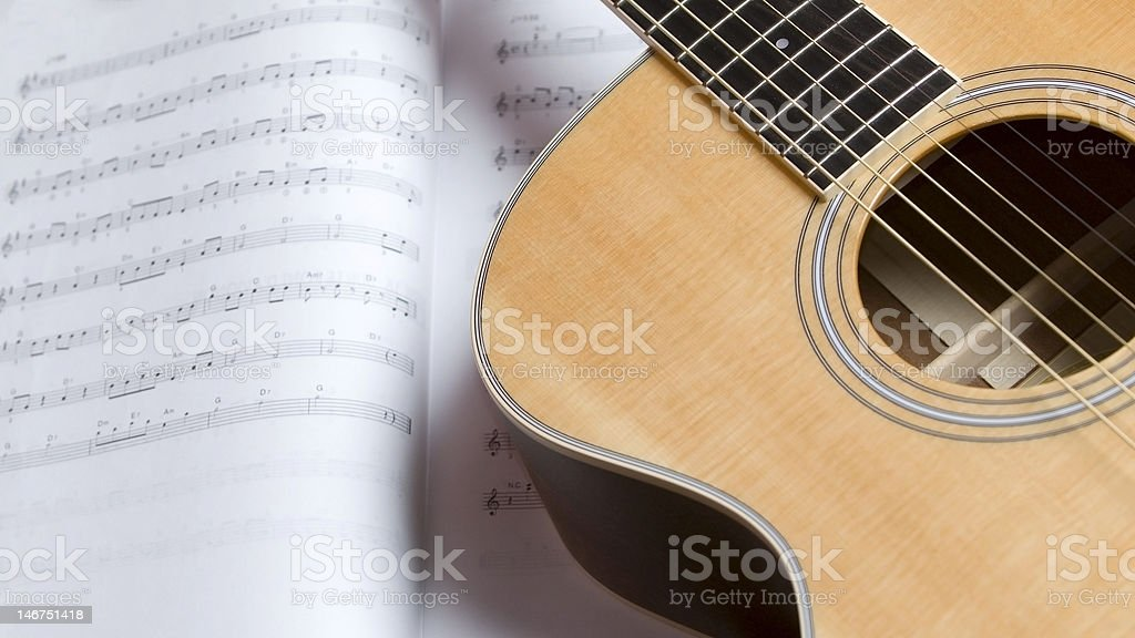 Acoustic Guitar on Sheet Music royalty-free stock photo