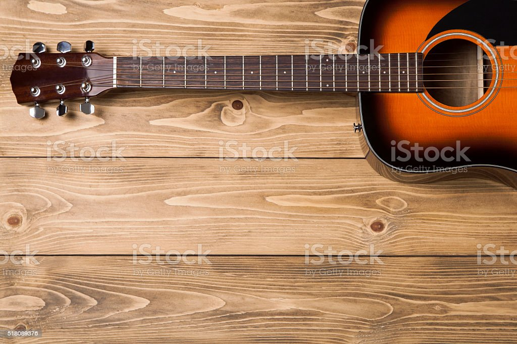 Acoustic guitar on wooden background stock photo