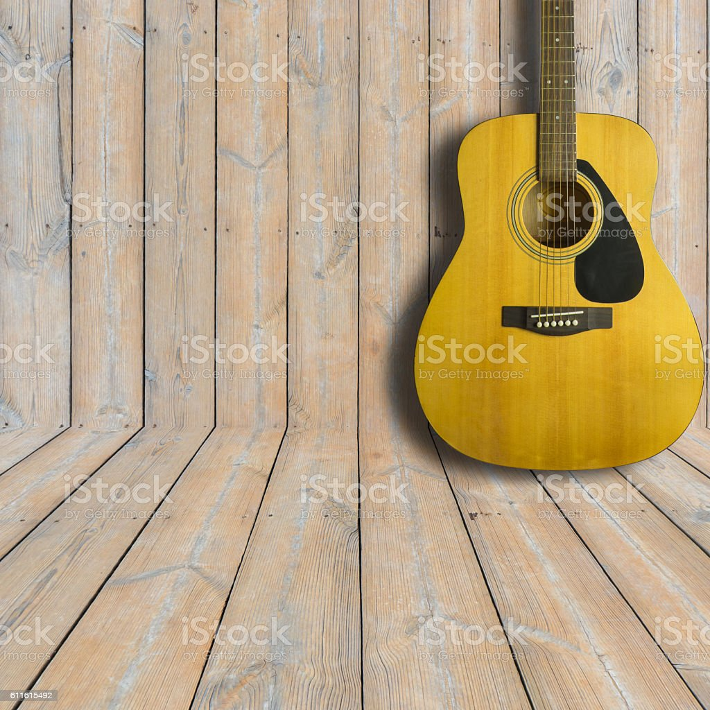 Acoustic guitar on wooden background texture.Copy space stock photo