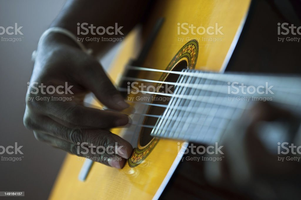 Acoustic Guitar player stock photo