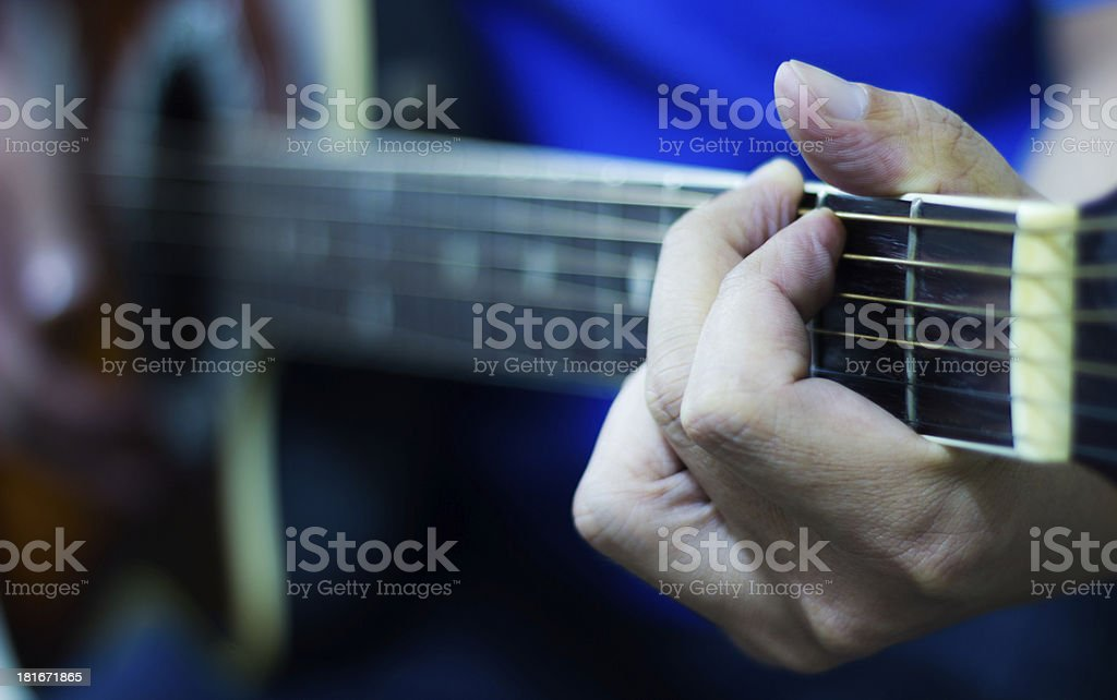 Acoustic Guitar Playing stock photo