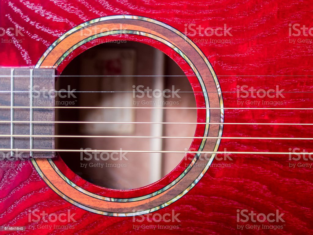 acoustic guitar sound hole, red wood, close up shot stock photo