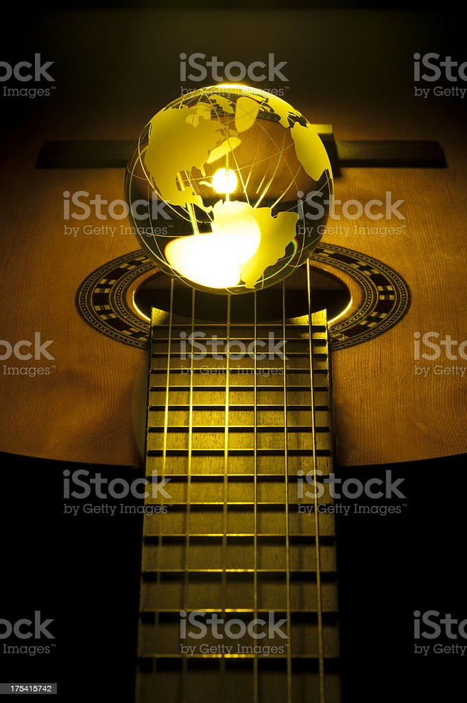 Acoustic guitar with globe stock photo