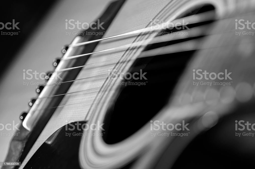 Acoustic Guitar with shallow depth of field, focus on strings stock photo