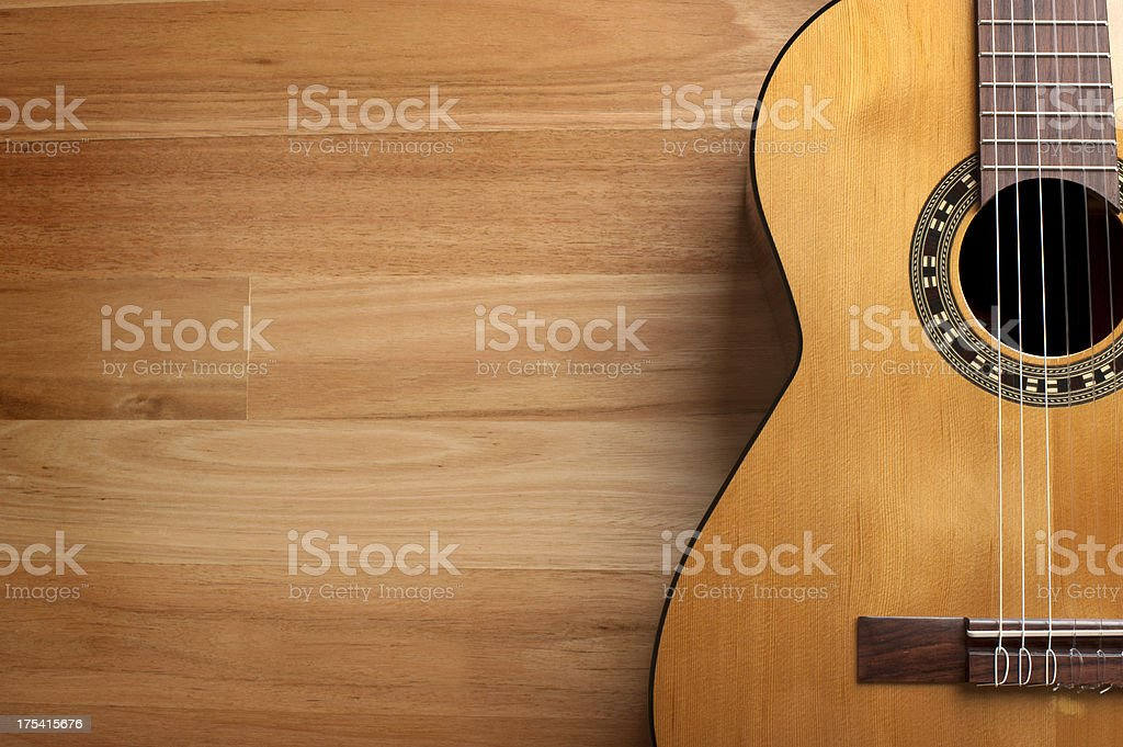 Acoustic guitar with wood background stock photo