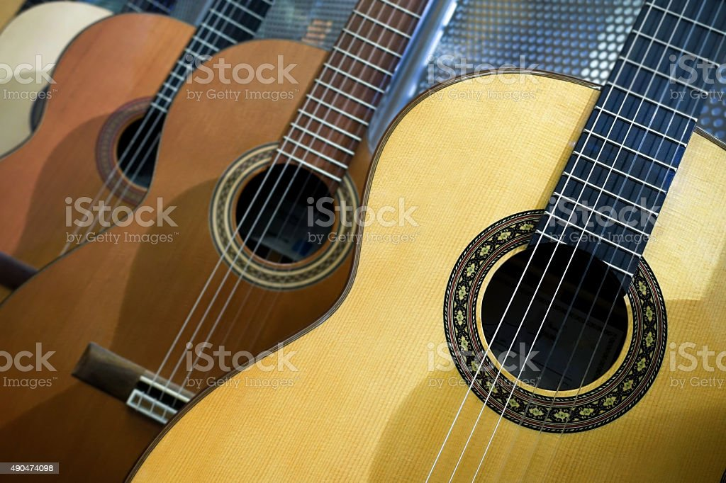 Acoustic guitars in a row stock photo