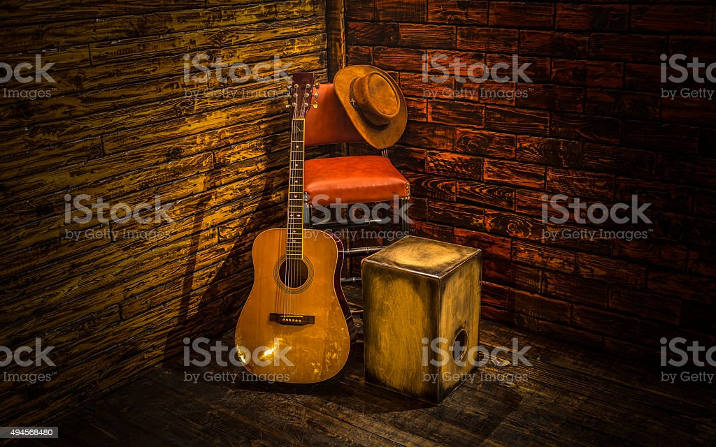 Acoustic instruments on small stage in bar stock photo
