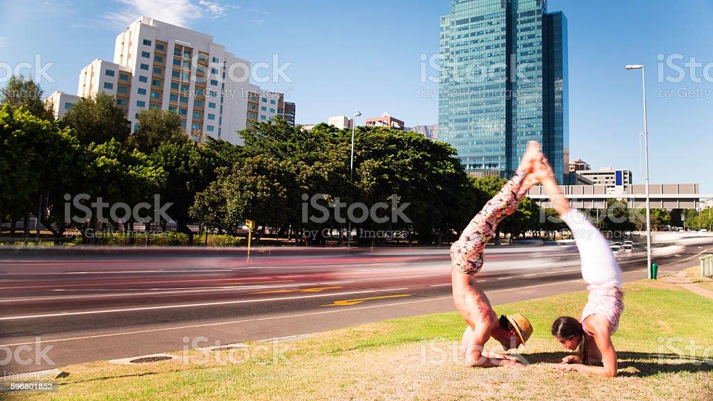 Acro yoga couple arm balance arch city motion blur stock photo