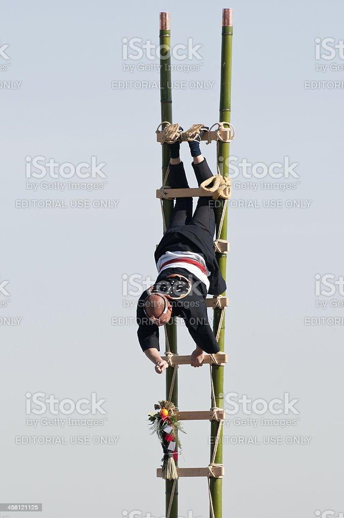 Acrobat on the ladder royalty-free stock photo