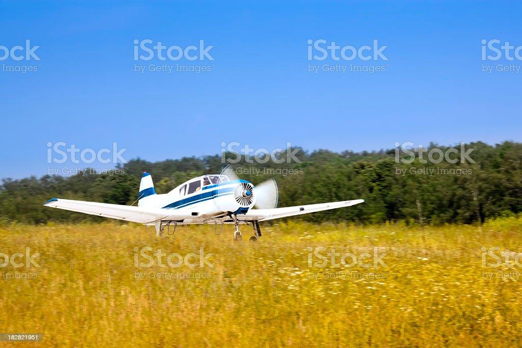 Acrobatic airplane Yak-18T taking off stock photo