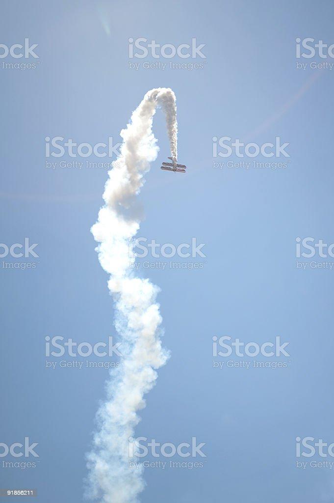 Acrobatic biplane performing at airshow. royalty-free stock photo