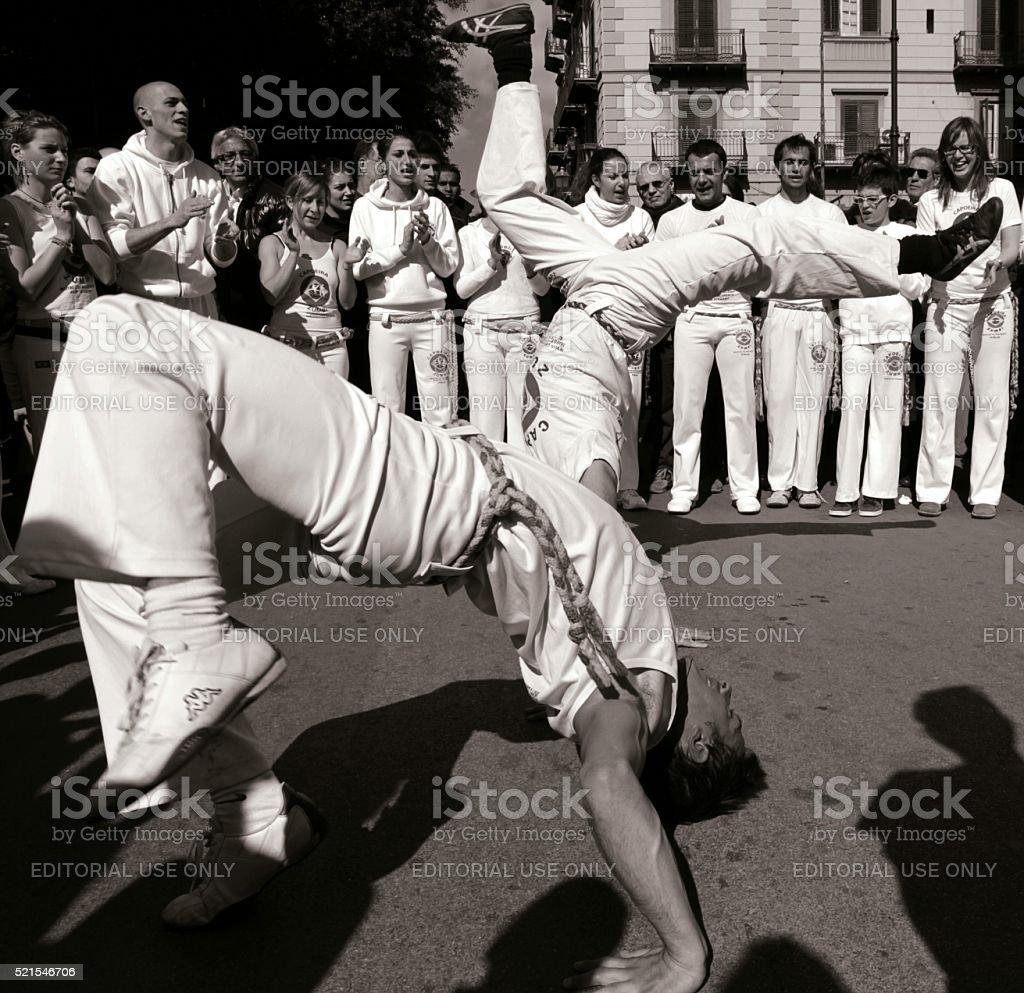 Acrobatic Capoeira double cartwheel stock photo