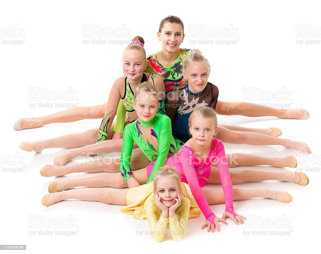Acrobatic Dancers Doing Split on white background royalty-free stock photo