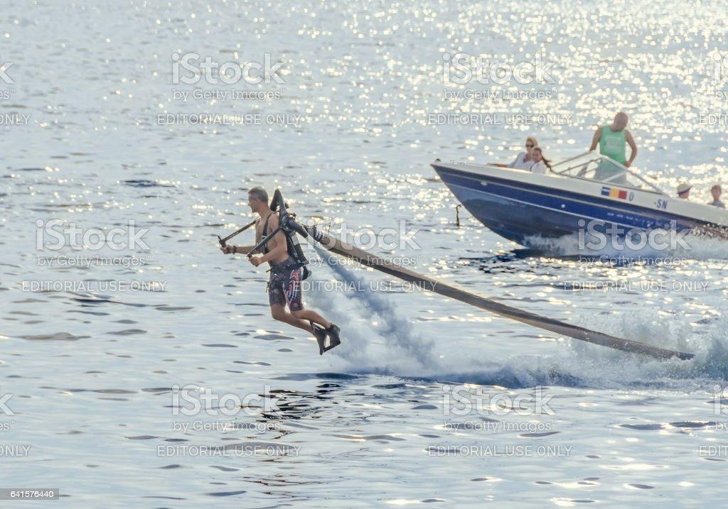 Acrobatic Jetsky pilot training on the lake. Aeronautic show. stock photo
