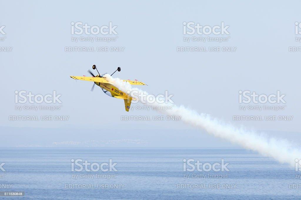 Acrobatic plane in action stock photo