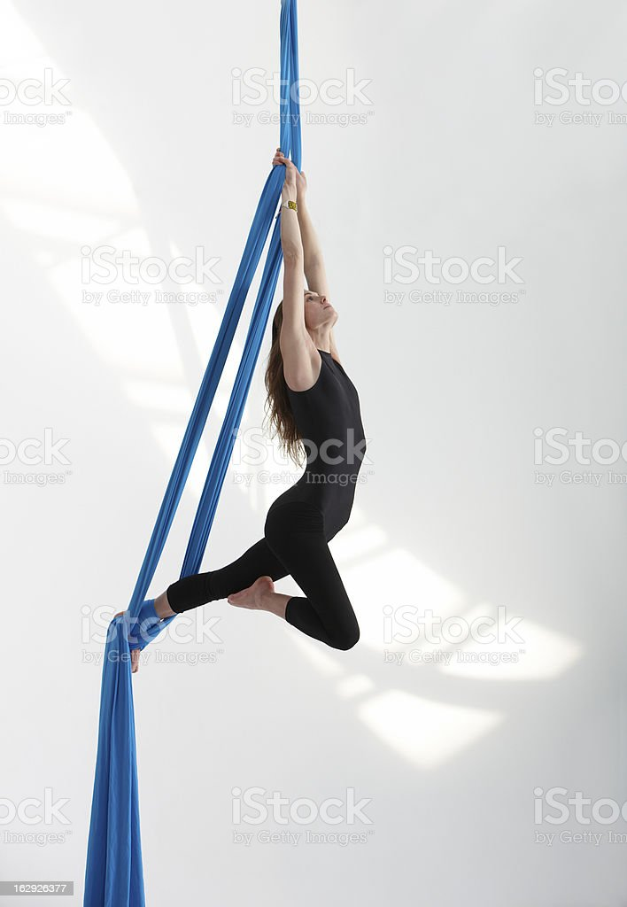 Acrobatic position with tissue stock photo