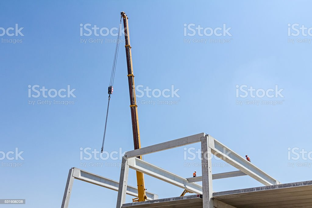 Acrobatic way of assembly concrete joist. stock photo