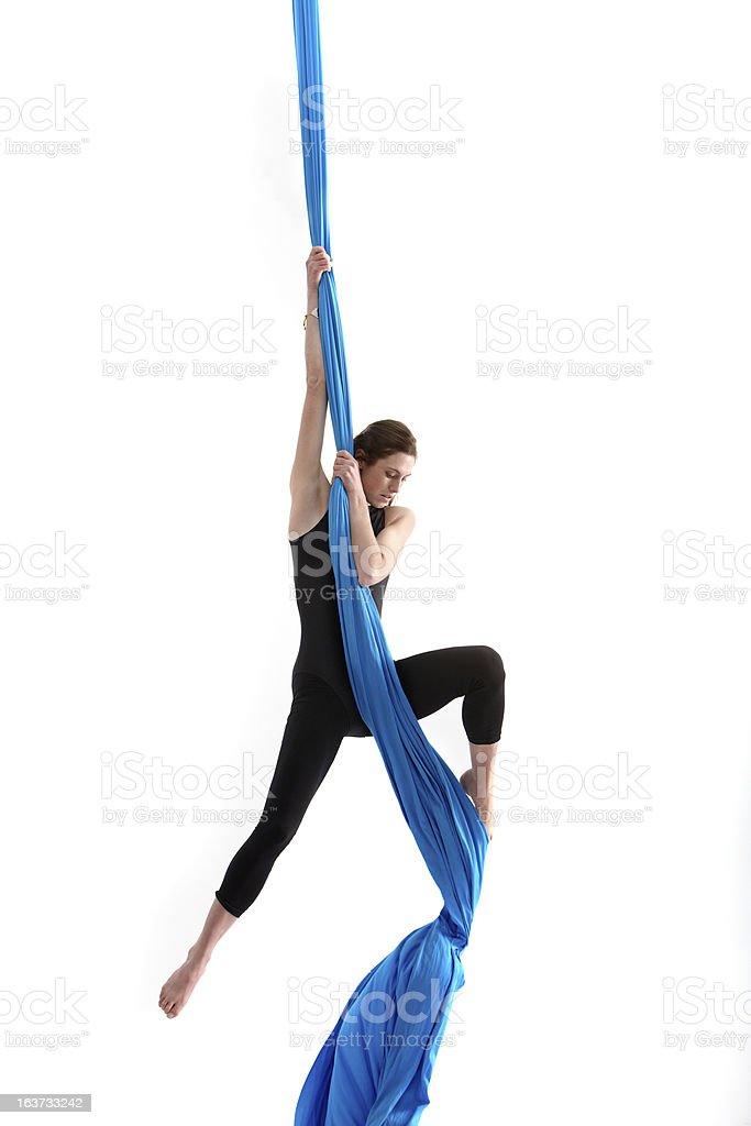 Acrobatic woman on silk tissue stock photo