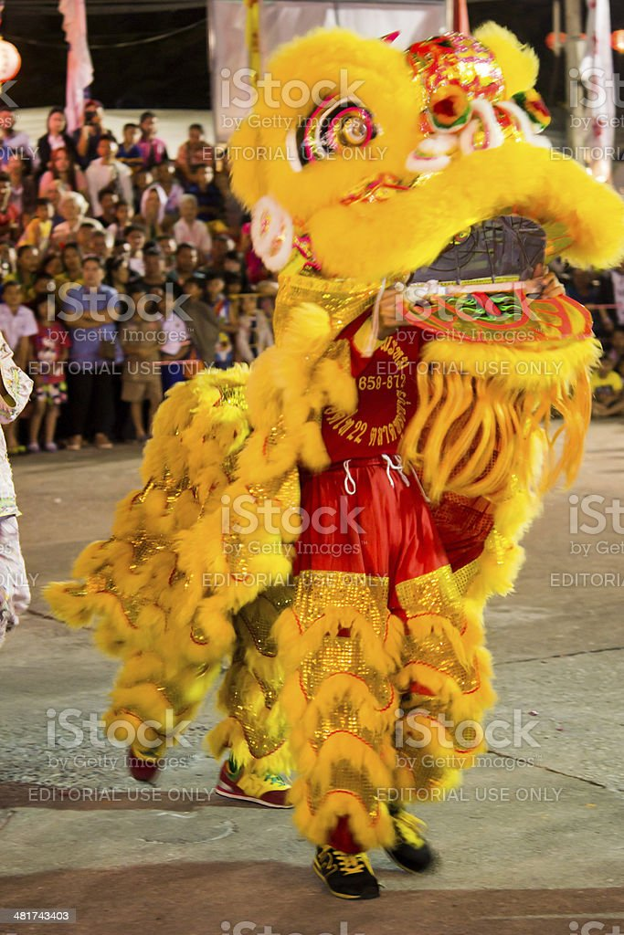 Acrobats are performing a lion and dragon dance stock photo