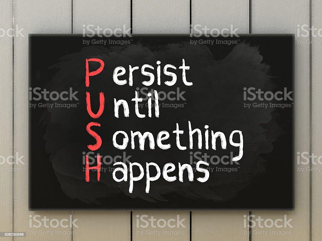 PUSH acronym on blackboard written with chalk. stock photo