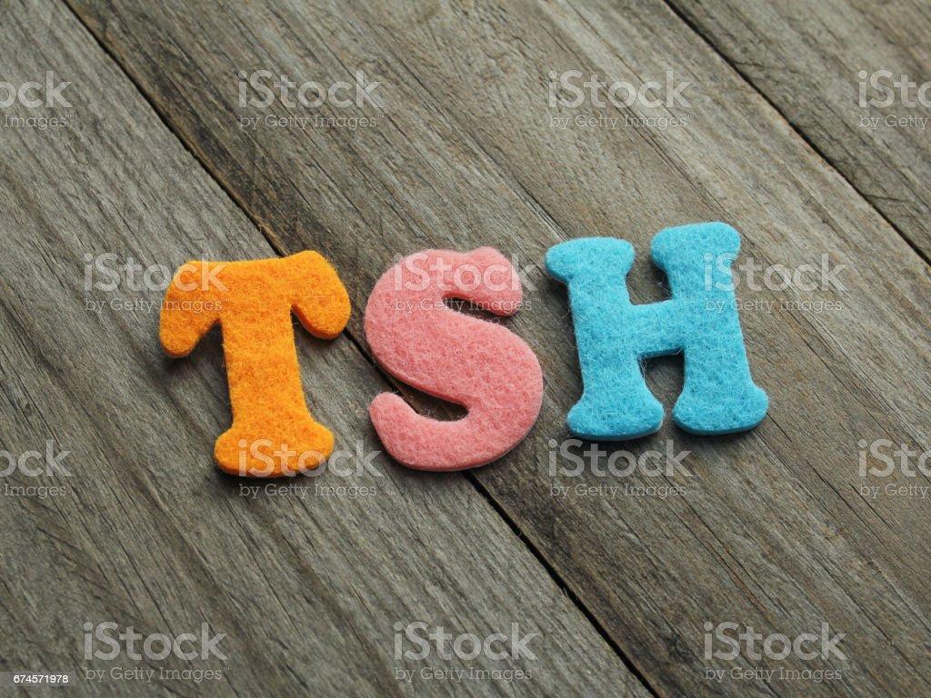 TSH acronym on wooden background stock photo