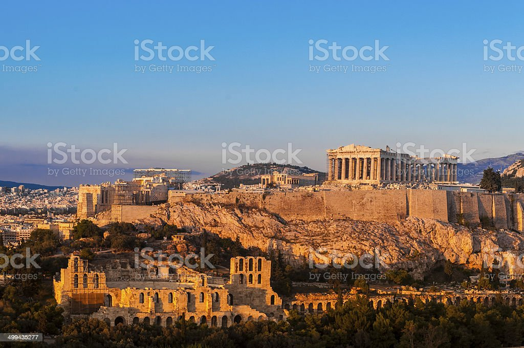 Acropolis Hill, Parthenon, Athens, Greece. Odeon Herodes Atticus. Golden Twilight. stock photo