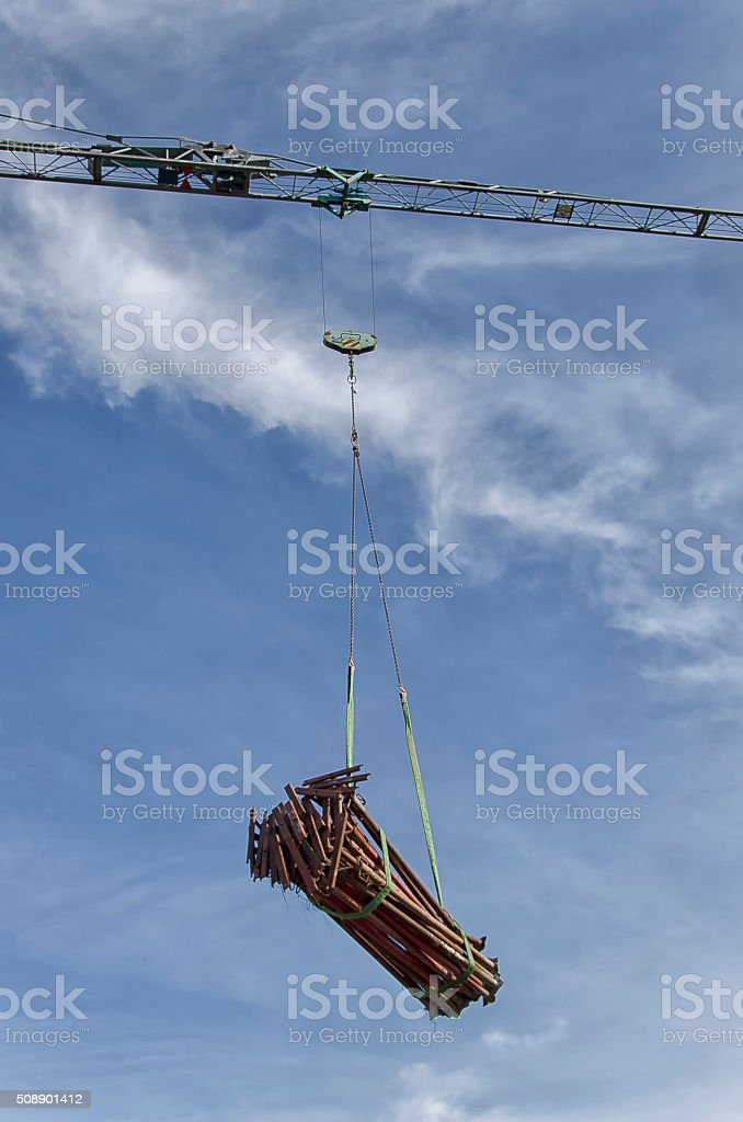 Acrow props moved by crane stock photo