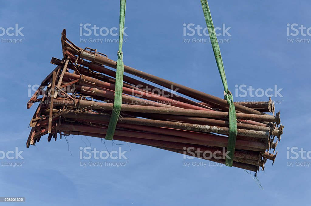 Acrow props moved within a construction site stock photo
