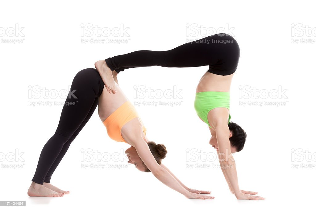 Acroyoga, downward-facing dog yoga pose stock photo