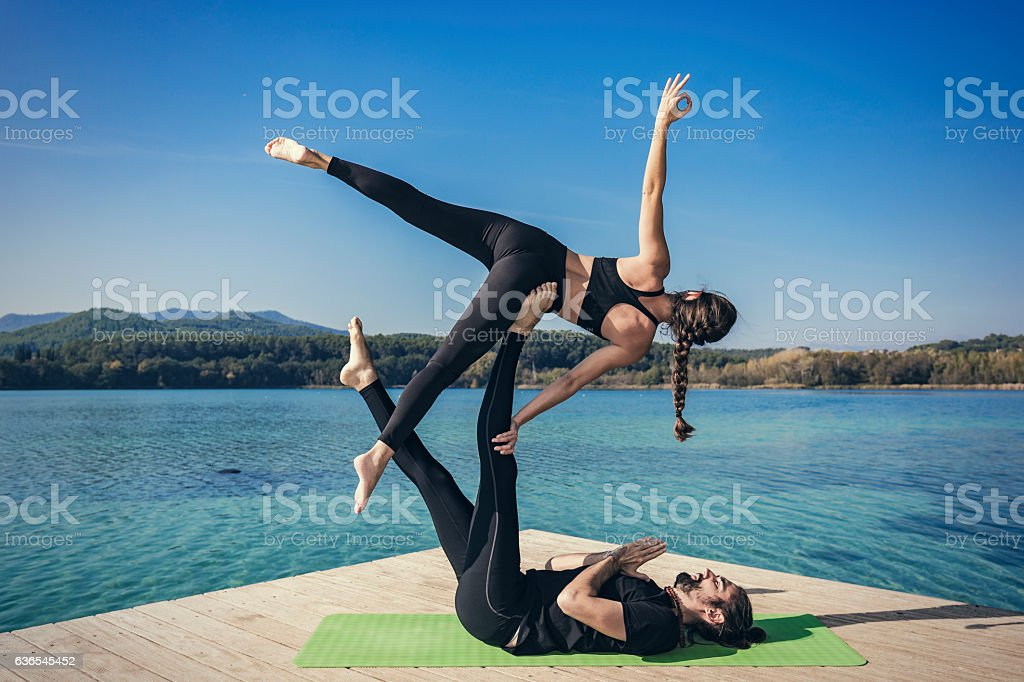 Acroyoga side star pose stock photo