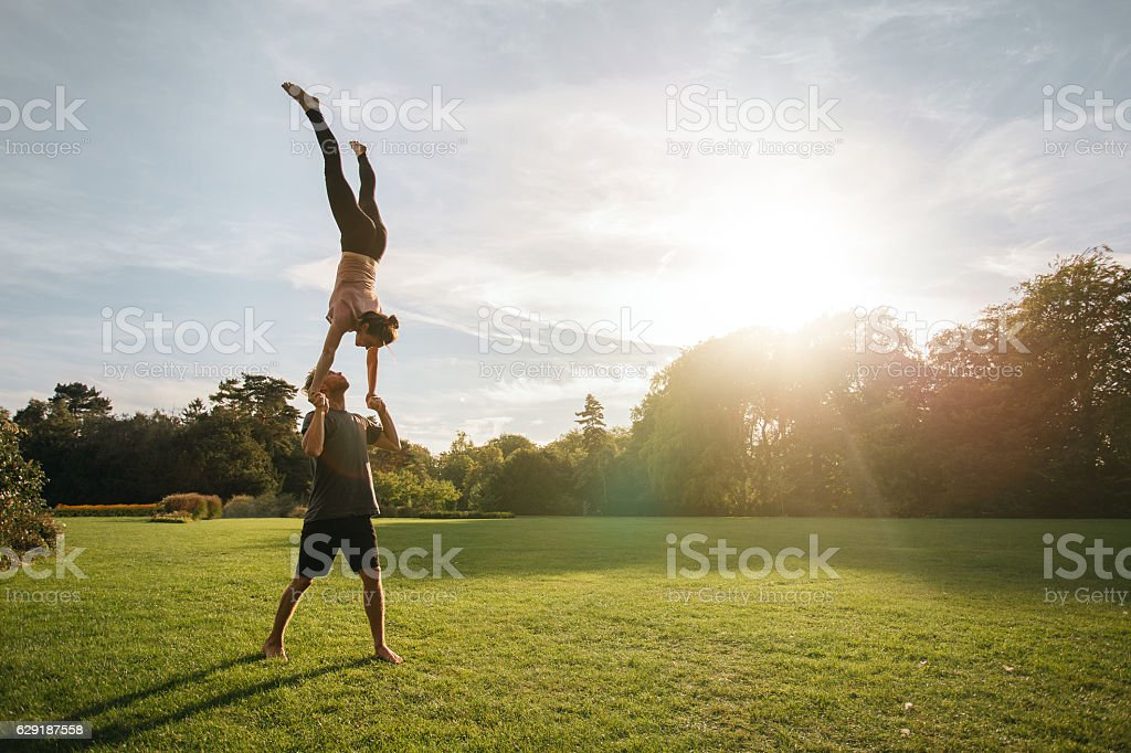 Acroyoga workout in park stock photo