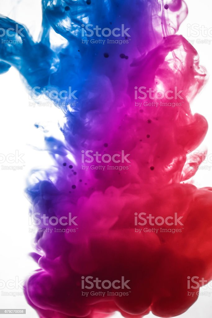Acrylic colors and ink in water. Abstract frame background. Isolated on white. stock photo