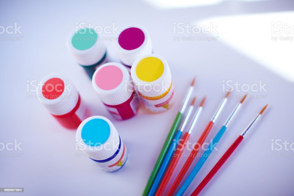Acrylic paints and delicate brushes are ready fro arts stock photo