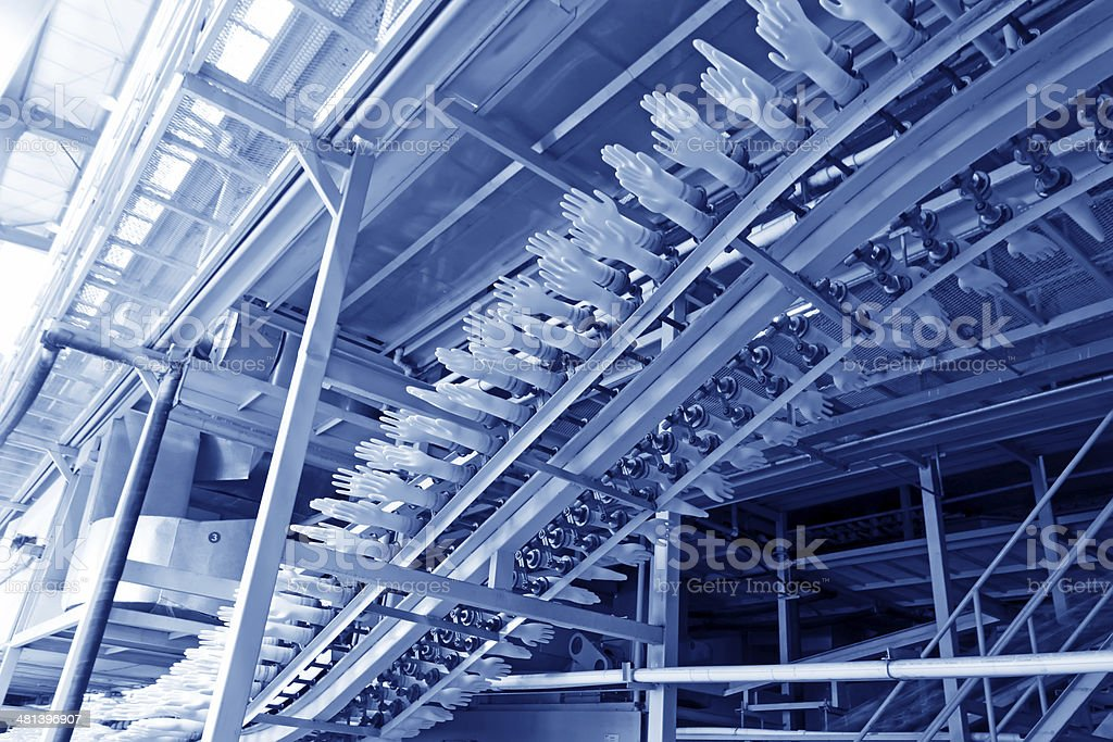 acrylonitrile butadiene gloves production line in a factory, nor stock photo
