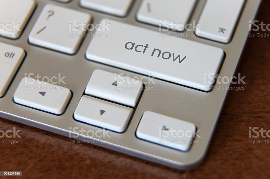 Act now button stock photo