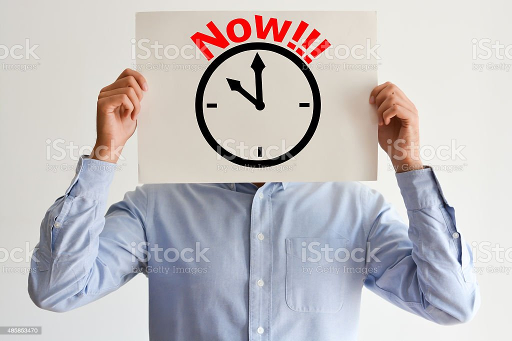 Act Now or deadline concept with stressed employee or businessman stock photo