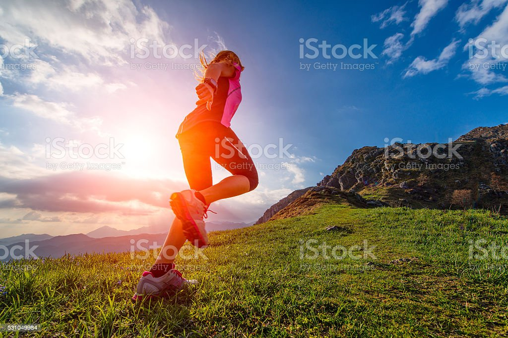 Action athletic of a girl running stock photo