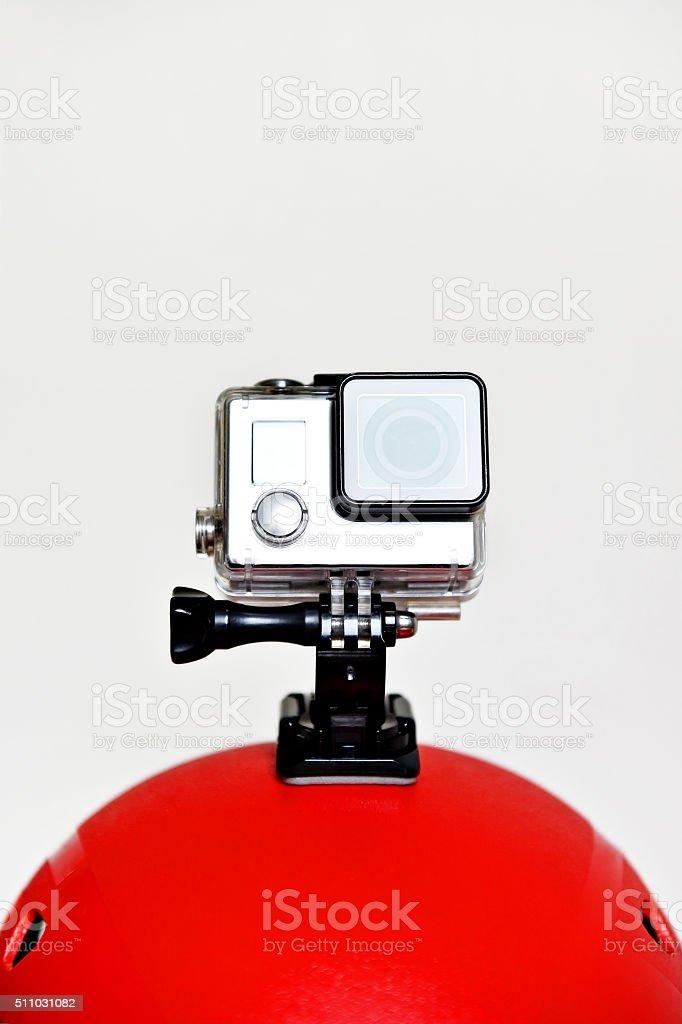 Action camera on red sport helmet stock photo